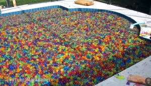 Watch What Happens When You Dive Into A Pool Filled With 25 Million Waterballs